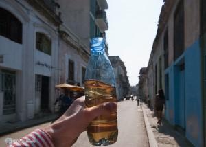 Жидкость в бутылке - какая то местная не крепкая самогонка
